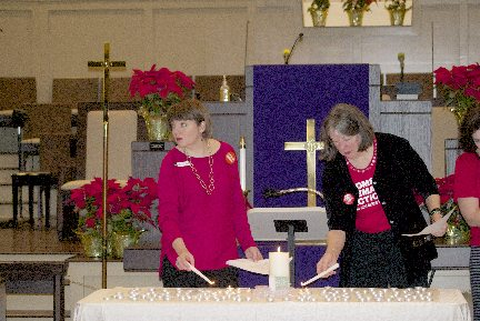 Moms Demand Action volunteers Jennie Hunter and Linda McFadyen-Ketchum light candles as the names of Davidson County Citizens who died in shootings in 2017 are read.