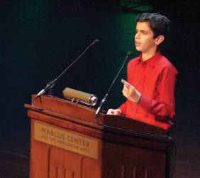 Amir Johnakin, winner of 3-4th grade speech category challenges the audience to stand up for justice. (Photo by Marcus Center of Performing Arts)