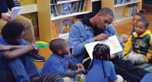 Ha Ha Clinton Dix, read students a book while sitting in the HERO Headquarters.