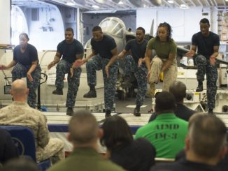 GULF OF ADEN (Feb. 23, 2017) Sailors and a Marine perform a step dance during the African American and Black History Month celebration aboard the amphibious assault ship USS Makin Island (LHD 8). The ship is deployed in the U.S. 5th Fleet area of operations in support of maritime security operations designed to reassure allies and partners, and preserve the freedom of navigation and the free flow of commerce in the region. (U.S. Navy photo by Mass Communication Specialist 3rd Class Devin M. Langer)