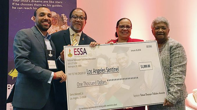 (Left-right) Brandon Brooks, the managing editor of the Los Angeles Sentinel; Dr. Benjamin F. Chavis, Jr., the president and CEO of the NNPA, Dr. Elizabeth Primas, the program manager of the NNPA ESSA awareness campaign; and Dorothy Leavell, the chairman of the NNPA, celebrate the Los Angeles Sentinel for the newspaper's engagement with the NNPA ESSA awareness campaign during the 2018 NNPA Mid-Winter Conference in Las Vegas, Nevada.