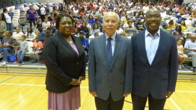 Kenneth Hill (right) founded ChiS&E in 2009. He is pictured with Chicago Public School execs.