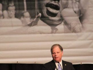 U.S. Senator Doug Jones spoke at the 32nd Annual Martin Luther King Unity Breakfast at the BJCC (Ariel Worthy/The Birmingham Times).