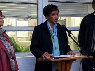Donna Edwards, candidate for Prince George's County executive, speaks during a Feb. 22 press conference outside the school administration building in Upper Marlboro as Phyllis Wright (left), parent of a county student, and Bob Ross, president of the county's NAACP chapter, look on. (William J. Ford/The Washington Informer)