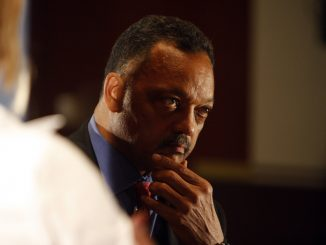 Reverend Jesse Jackson Sr. takes a moment to reminisce about Election Night after Vice President Ann Marie Lipinski asks him a question about President Obama's speech in Grant Park. Taken at the Max Palevsky Cinema in Ida Noyes.