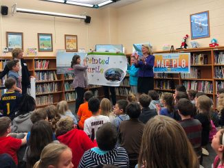 Secretary of State Ruth Johnson has fun with third grade students at Gates Elementary School in Davison on March 23 as part of a National Reading Month visit.