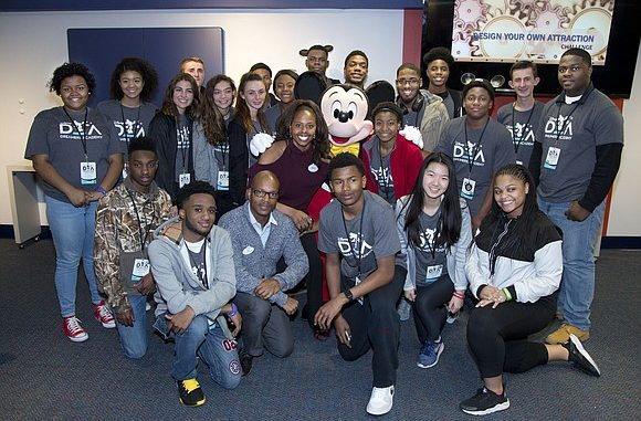 Mickey Mouse surprises students during a hands-on Imagineering and engineering workshop Friday, March 9, 2018, as part of Disney Dreamers Academy with Steve Harvey and ESSENCE at Walt Disney World Resort in Lake Buena Vista, Fla. The 11th annual Disney Dreamers Academy, taking place March 8-11, 2018 is a career-inspiration program for distinguished high school students from across the U.S. ( GREGG NEWTON PHOTO