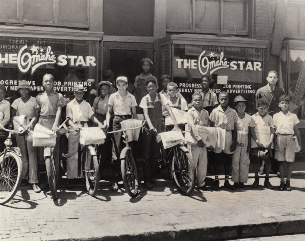 Newsboys for The Omaha Star are lined up outside the offices for the paper in the 1940s.