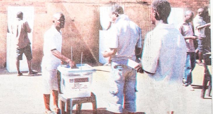 """Prisoners here in Malawi do vote,"" said Augustine Suwedi Chidzanja, an election official in the Salima Central District, as an assistant observed that he didn't see a deterrent that would keep Americans in prison from returning to prison upon release because ""all their rights"" have been taking away. (Photo: Kondwania Kamlyala)"
