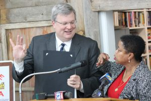 "Memphis City Councilwoman Jamita Swearengen teaches Mayor Jim Strickland how to do ""the Orange Mound"" sign – an 'OK' sign creates the ""O"" and inverted, the three fingers creates the ""M."""
