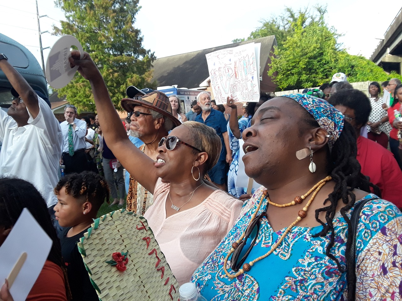 Erica Williams Mitchell, Phyllis, and Owusu Bandele, Ph.D. sing along with the crowd gathering at Sadie Roberts-Joseph vigil at the Baton Rouge African-American History Museum. Photo by Antione GHOST Mitchell @the_art_alchemist