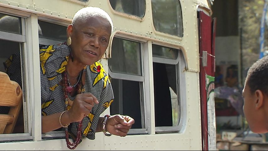 While leaning from the historic bus, archivist Sadie Roberts-Joseph delivers a presentation on the 1953 Baton Rouge Bus Boycott to tourist visiting the museum. Photo by James Terry III.