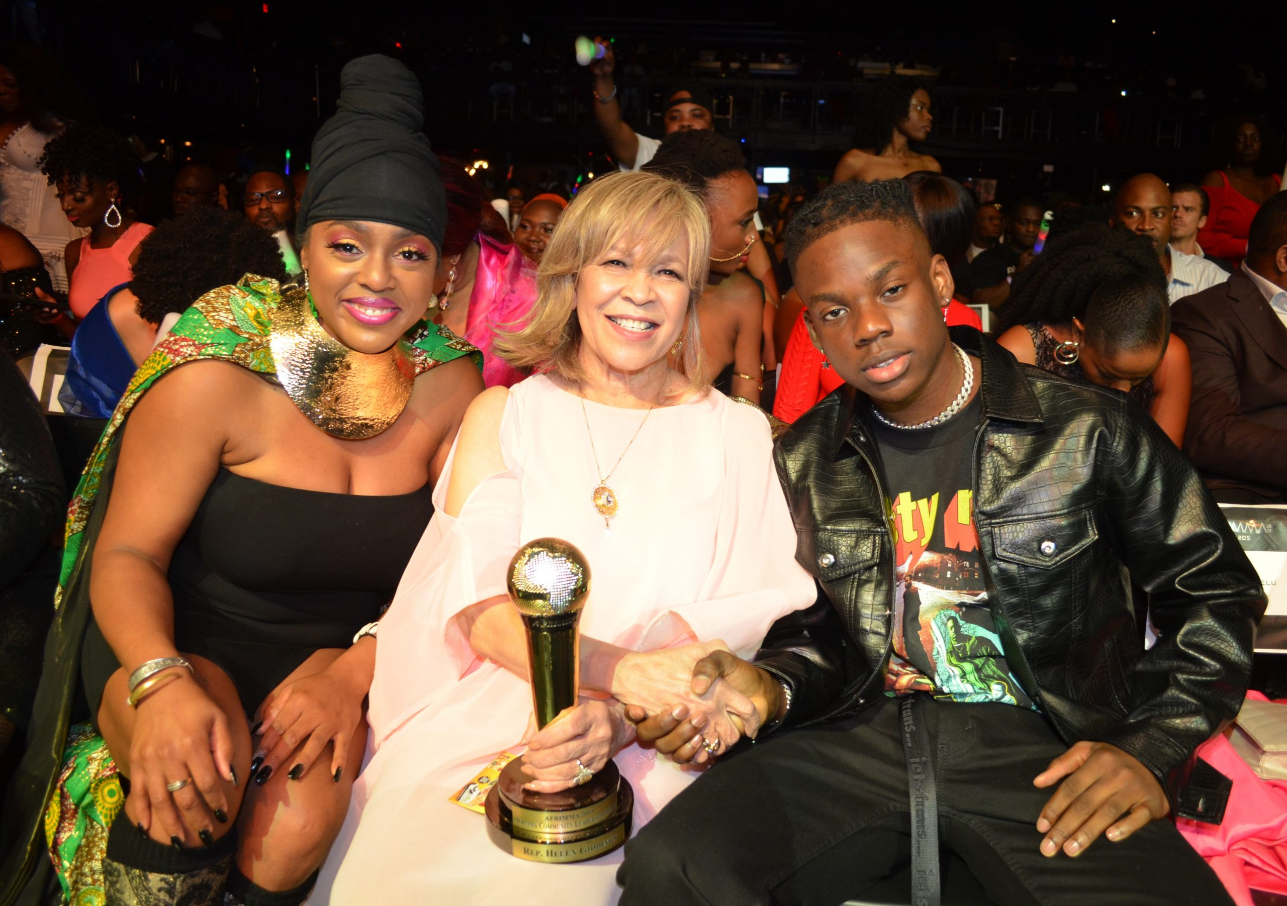 Ms. Helen Giddings (sitting) Left to Right: Queen Cora Coleman (Drummer for Prince and Beyoncé); Helen Giddings (Former member Texas House of Representatives for 26 years); and Rema (19-year-old Nigerian Singer and Rapper, who won AFRIMMA's Video of the Year Award). Photo Credits: Earnestine Cole
