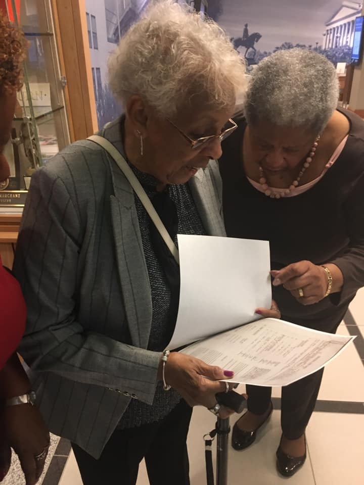 Celestine Parson Lloyd, left, and sister-in-law Annie Camacho look at her nearly 70-year-old test from Dr. Kenneth Clark's famous doll experiment. Researchers at the University of South Carolina Center for Civil Rights History discovered the test at the Library of Congress and presented it to her on Jan. 15.