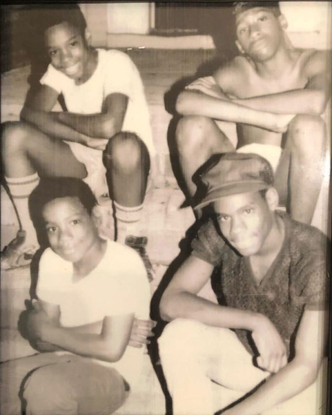 Brothers Freddy Hawkins, Amir Hawkins and Yusuf Hawkins with friend Christopher Graham photo by HBO